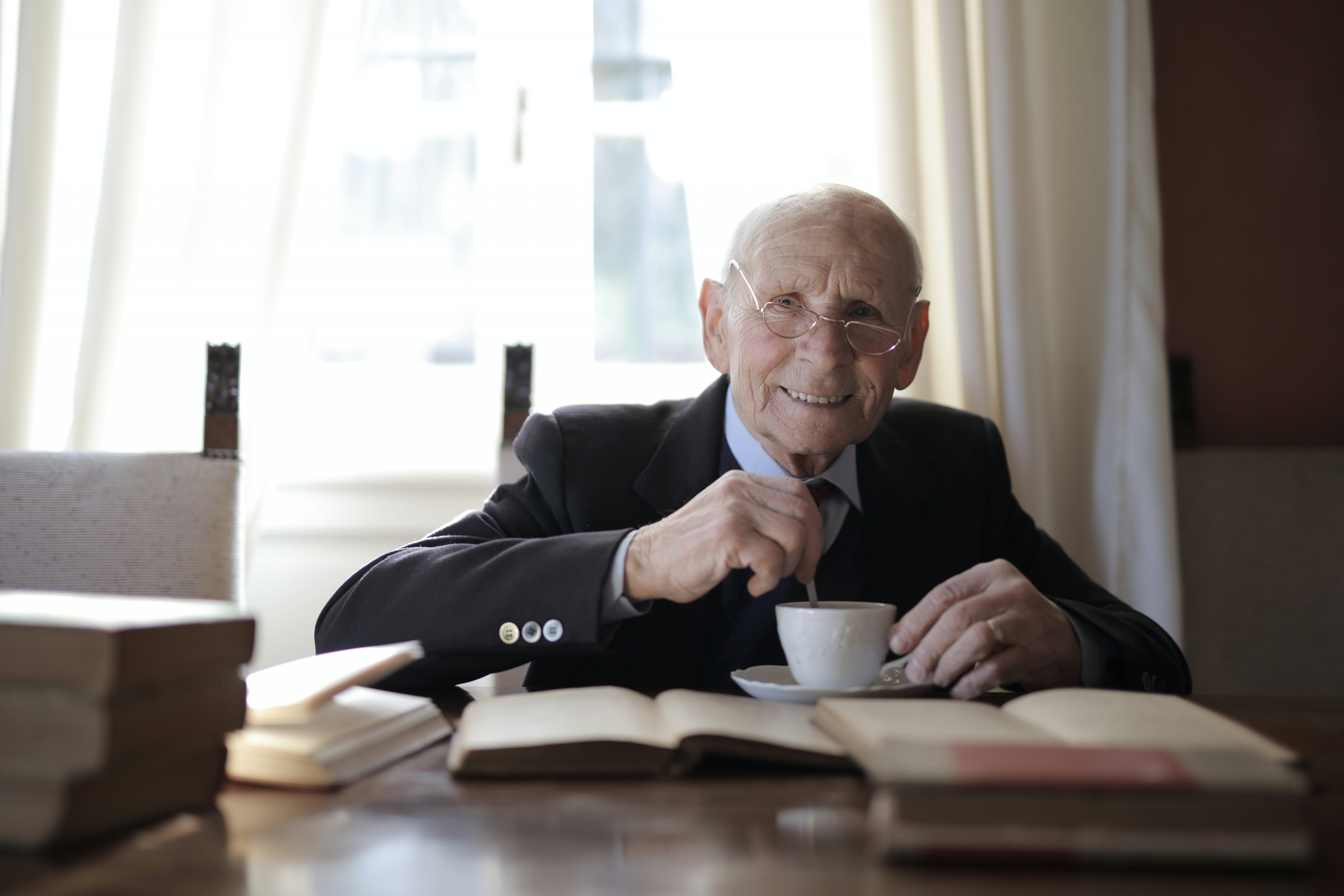 senior man in formal suit drinking hot drink while sitting 3823447 scaled