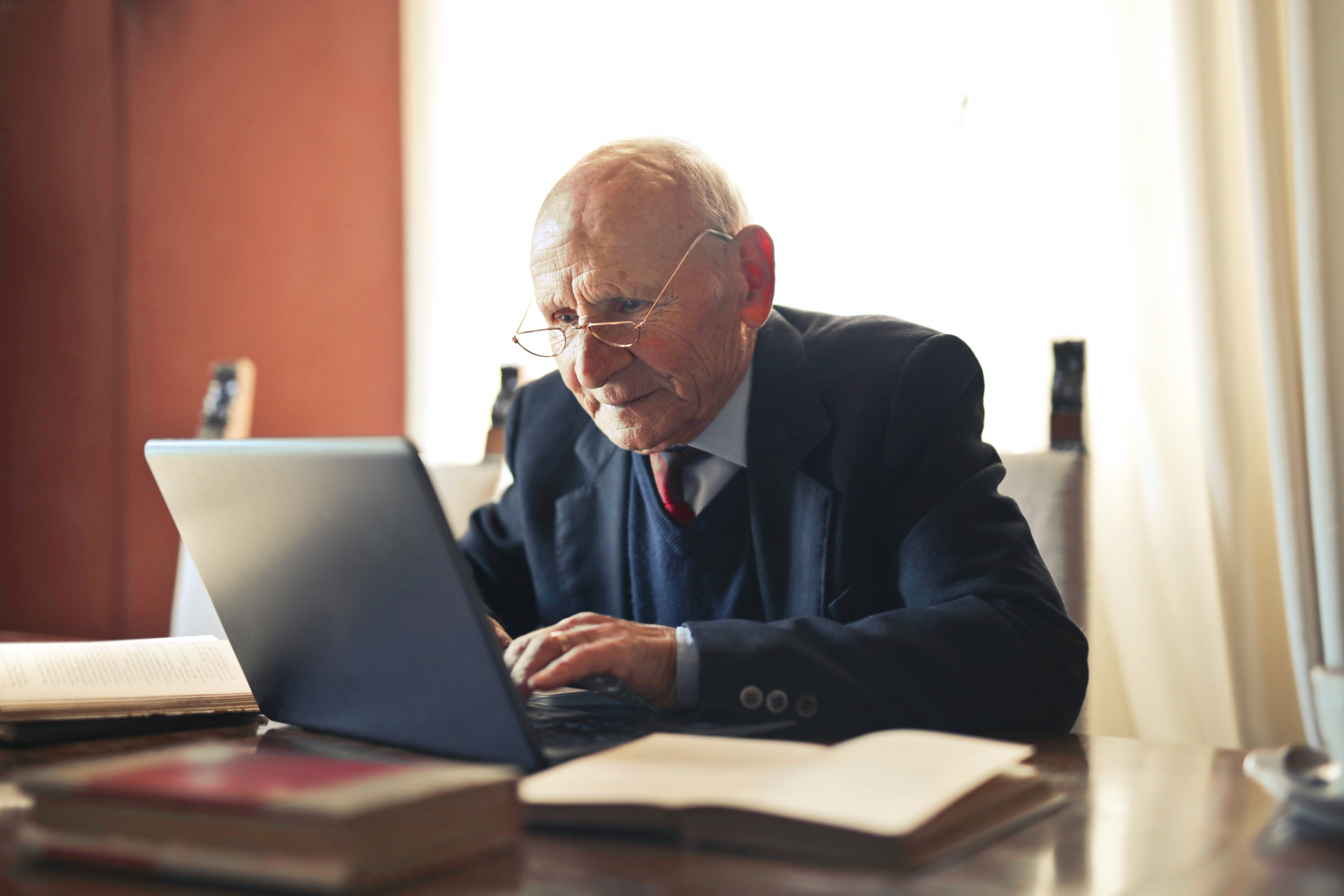 serious senior man in formal suit working on laptop at 3823494 1 scaled